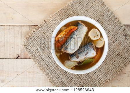 Thai food spicy mackerels fish Tom yum canned mackerels in tomato sauce on sackcloth pat.Top view