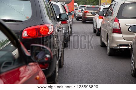 Close up of cars in a traffic jam on rush hour in a city