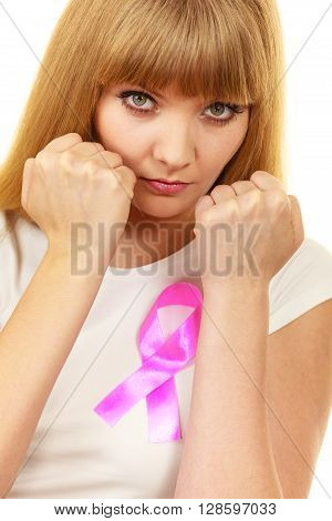 Woman Wih Pink Cancer Ribbon On Chest Punching