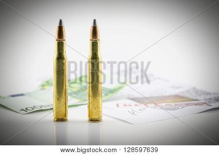 composition with bullets money and documents of the investigation