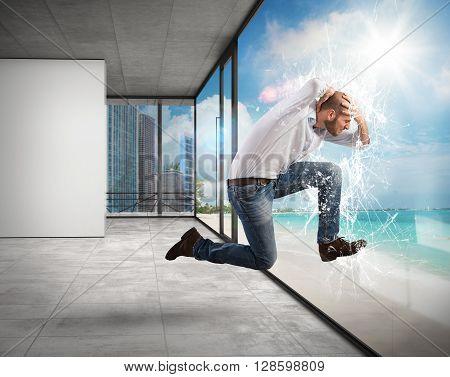 Man breaks a window of an office