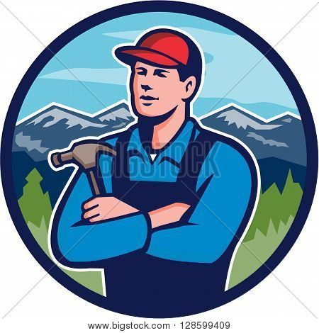 Illustration of a kitchen bathroom remodeler builder carpenter holding hammer with arms crossed viewed from front set inside circle with mountains in the background done in retro style.