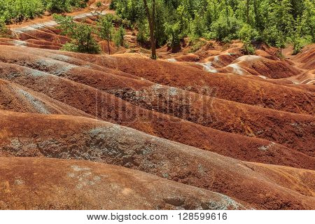 Cheltenham Badlands background is a small example of badlands formation in Caledon, Ontario, Canada,  because of bad farming practices