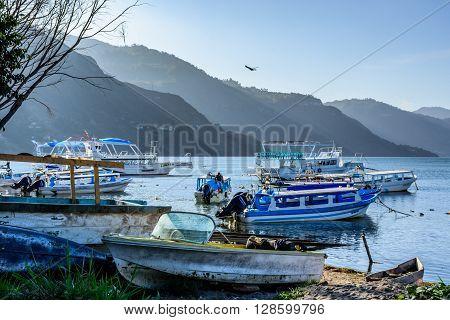 Lake Atitlan Guatemala - April 3 2016: Early morning light on moored boats at edge of Lake Atitlan, Guatemala.