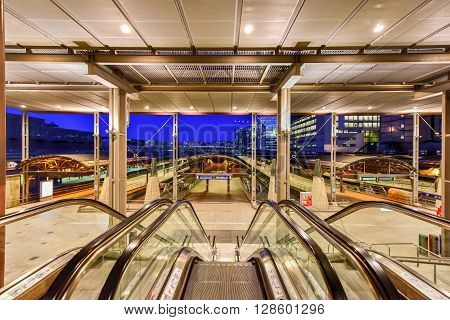 Oslo, Norway - February 27, 2016: Escalators leading to the tracks at the Oslo Central Station. It is the main railway station in Oslo and the largest railway station on the entire Norwegian railway system.