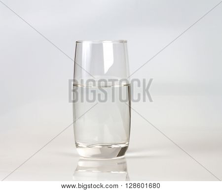 a glass of fresh drink water on white backgrund