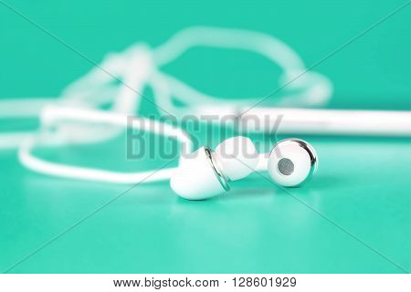 selective focus of the white earphones for using with digital music or smart phone