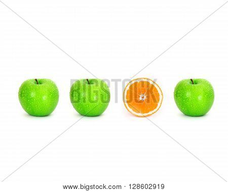 sliced orange place on white background among green apple with water droplet , unique or different concept