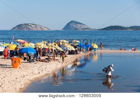 RIO DE JANEIRO, BRAZIL - MARCH 27, 2016: People enjoying sunny weekend at crowded Ipanema beach.