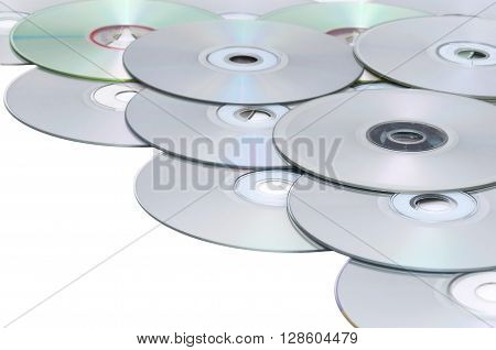 Close-up of CDs lying on each other on a white background