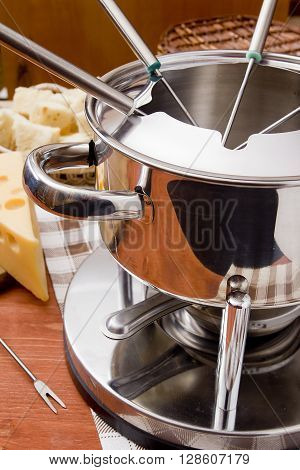 Special set of utensils for cooking cheese fondue