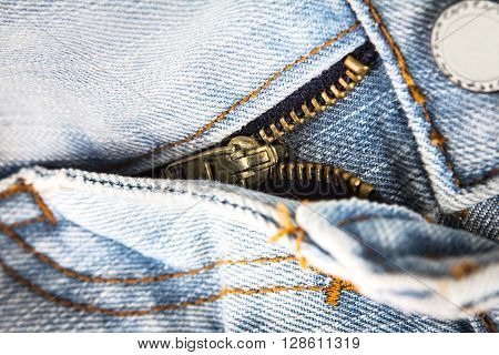 closeup metal zipper of the jeans pants selective focus