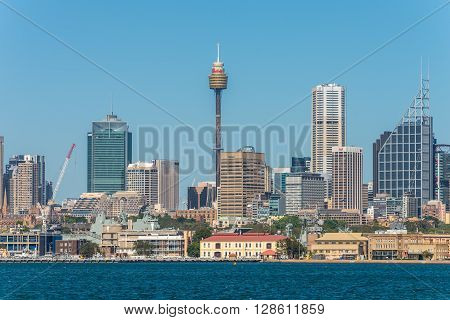 Sydney Australia - November 9 2014: Australian Sydney landmark - city CBD high rises and towers forming megapolis cityscape summer day from harbour Sydney New South Wales Australia.