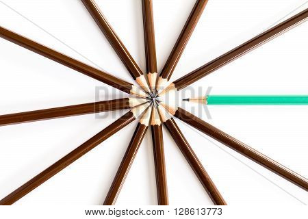 brown wooden pencil arrange as circular with one of different pencil try to close the gap on white background , un matching and competition concept