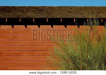 a picture of an exterior late 19th century red barn wall