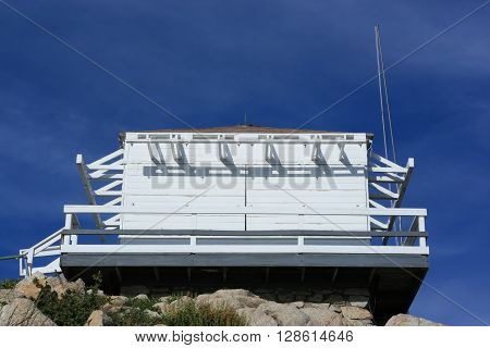 a picture of an exterior forest fire lookout tower