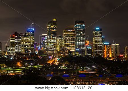 Sydney Australia - November 10 2014: Unusual night view of Sydney central business district. Royal Botanic Gardens in the center Sydney New South Wales Australia