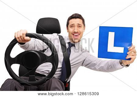 Confident young driver holding a steering wheel and an L sign isolated on white background