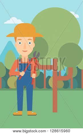 Farmer with pruner in garden.