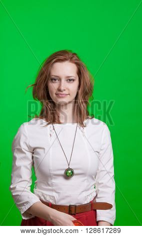 Smiling girl in a vintage dress on green background