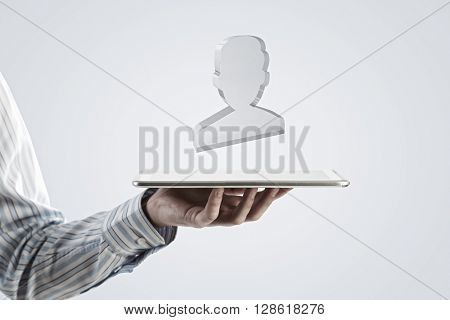 Tablet in hand with symbols