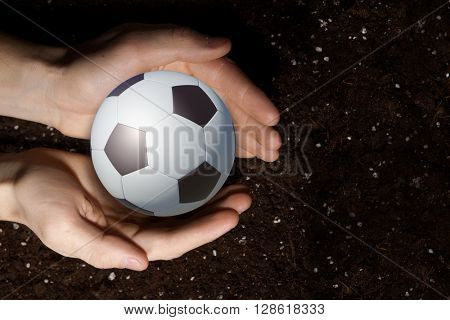 Soccer ball in palms