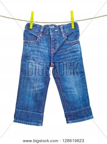 Jeans on clothesline on a white background