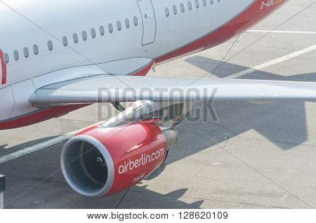 DUESSELDORF NRW GERMANY - MARCH 18 2015: Up Duesseldorf airport jet engine of an aircraft of Air Berlin. View of the tarmac.