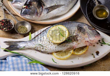 Fresh Uncooked Dorado With Olive Oil And Spices