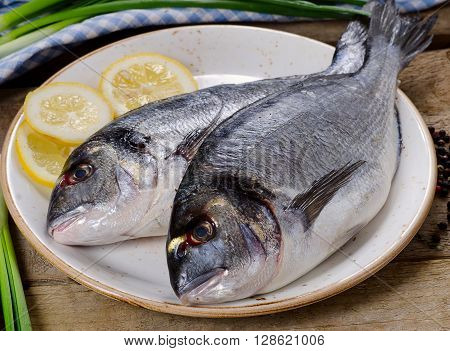 Fresh Uncooked Dorado Or Sea Bream On A Plate.