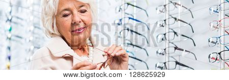 Woman Holding Glasses