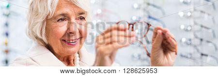 Senior Buying Eyeglasses