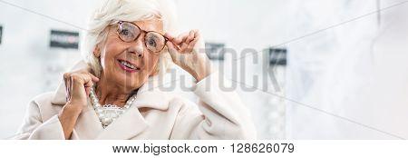 Woman Putting Glasses