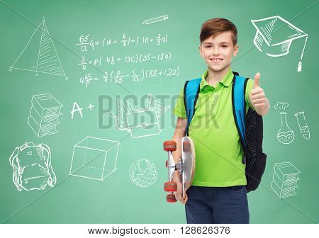 childhood, gesture, education and people concept - happy smiling student boy with backpack and skateboard showing thumbs up over doodles on green chalk board background
