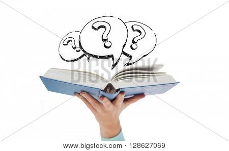 education, school, learning and information concept - close up of woman hand holding open blue book with doodles