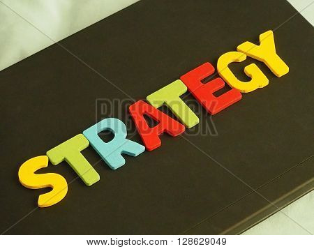 Colorful of Strategy word on black background. Business strategy concept. Marketing strategy concept.