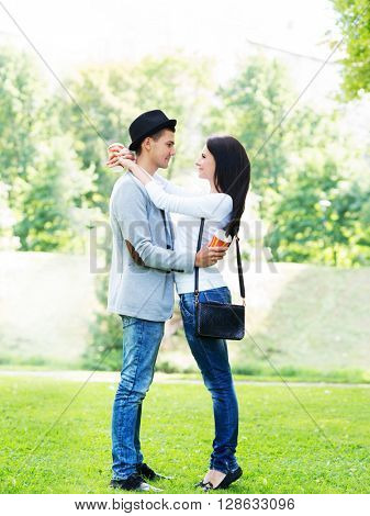 Young beautiful couple full length in the park.