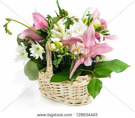 basket of flowers orchid and freesia, isolated on white background