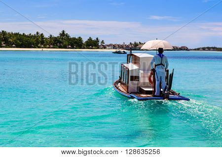 Maldivian boat on blue lagoon, indian ocean