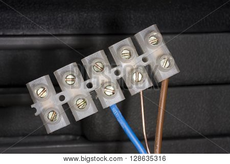 Plastic wire connection block with three core UK specification 13 amp cable.