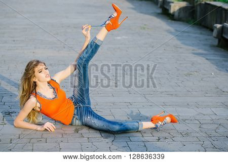 Young Woman Lying On The Land In A Park