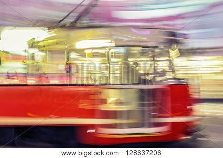 Creative abstract city transportation and business travel technology industrial concept: red tram on urban city street with motion blur effect. Katowice. Poland.