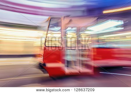 Creative abstract city transportation and business travel technology industrial concept: red tram on urban city street with blur effect in Katowice. Poland.