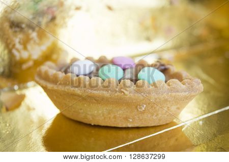 closeup of a pastry with chocolate cream and colored comfit