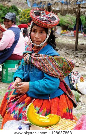CUSCO PERU - APRIL 05: Portrait of the woman from the Sacred Valley in the Cusco area selling pumpkins at the market in South America in April 05 2012