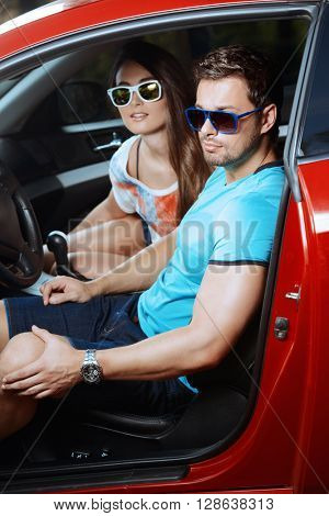 Portrait of a beautiful young people driving in the car.