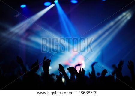 Fans dancing during the concert of popular singer