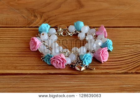 bracelet with flowers made of polymer clay, plastic beads and metal pendants. Beautiful bracelet for girls. Girl style