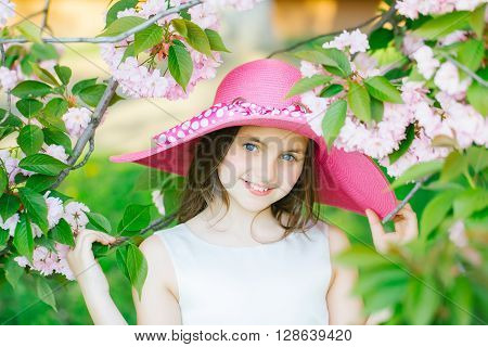 Girl In Hat With Bloom