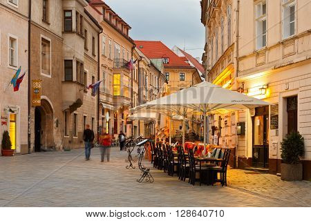 BRATISLAVA, SLOVAKIA - MAY 04, 2016: People in one of the main streets of the old town in Bratislava on May 04, 2016.
